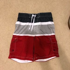 Red, gray, white and navy blue swim trunks